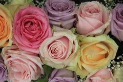 Pastel roses in bridal arrangement Stock Images