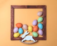 Pastel scattered Easter eggs framed with bunny stock images