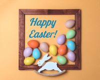 Pastel scattered Easter eggs framed with bunny royalty free stock image