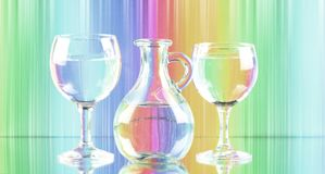 Pastel shades image of two wine glasses and a jug of fresh clean water. canvas print wall art. Pastel rainbow shades coloured background refraction through water Royalty Free Stock Images