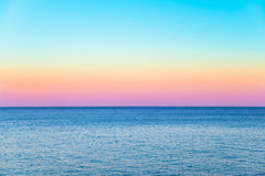 Pastel sky with a calm sea beneath. And a clear horizon Royalty Free Stock Photos