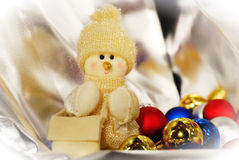 Pastel snowman and Christmas-tree decorations Stock Photos