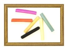 Pastel sticks in frame. Six color oil pastel sticks on white placed in frame Stock Images