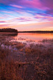 Pastel Sunrise at Lake Jacomo. A 106 second long exposure shot of sunrise of Lake Jacomo in Blue Springs, Missouri.  The sky has pastel colors and the long Stock Photos