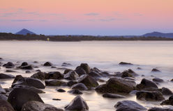 Pastel sunrise over Noosa Rocks. Noosa, on the northern end of Queensland's Sunshine Coast, enjoying a warm sunrise Stock Photo