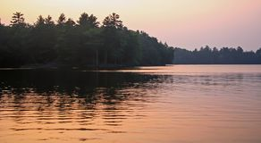 Wilderness Lake at Dusk. Pastel sunset on a calm, wilderness lake Royalty Free Stock Photo