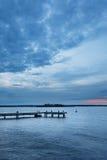 Pastel sunset over Swedish Stockholm archipelago landscape with jetty Royalty Free Stock Photo