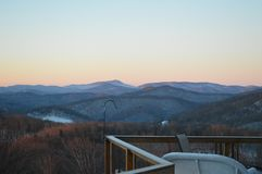 The pastel sunset viewed from the deck royalty free stock photography