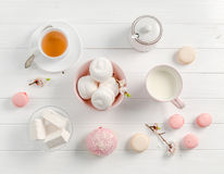 Pastel sweets, tea and milk, topview Stock Photography