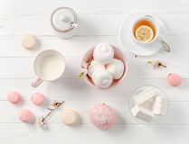 Pastel sweets, tea and milk, topview Stock Photos