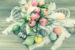 Pastel tulip flowers and easter eggs. retro style Stock Photo