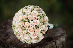Pastel wedding bouquet with roses on wood. Colorful wedding bouquet with roses on wood Stock Photos