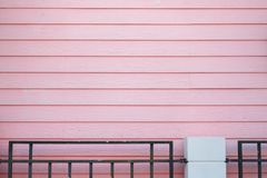 Pastel wooden wall for home with black steel fence. The pastel wooden wall for home with black steel fence Stock Photos