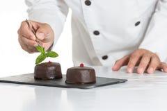 Pastelaria com um bolo Fotos de Stock Royalty Free