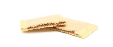 Pastelaria do açúcar de Brown quebrada ao meio Fotos de Stock