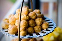Pastelarias de sopro de creme Fotos de Stock