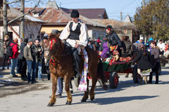 Pastele Cailor Festival. Image taken at the Tudorita festival in Targoviste, Romania. Tudorita or Pastele Cailor festival took place March 3. Horse and carrige Stock Images
