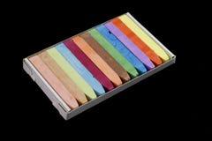 Pasteles coloridos de la tiza aislados en negro Imagen de archivo libre de regalías