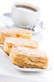 Pasteles con la taza de café Foto de archivo