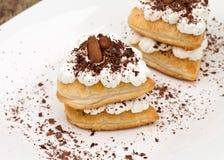 Pasteles de soplo dulces fotografía de archivo