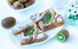 Pasteles de un kiwi Foto de archivo