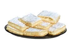 Pasteles dulces en blanco Imagen de archivo libre de regalías