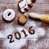 Pasteles y número 2016, como el Año Nuevo Fotos de archivo