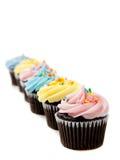 Pastelkleur cupcakes op een witte achtergrond royalty-vrije stock afbeeldingen