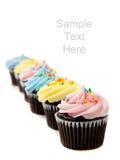 Pastelkleur cupcakes op wit met exemplaarruimte Royalty-vrije Stock Foto