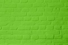 Pastell bright green colored brickstone wall. Full frame, image background royalty free stock images