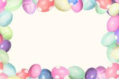 Pastell färgade easter ägg i en ram, copyspace för egen text Arkivfoton
