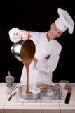 Pastella di torta di versamento Fotografia Stock