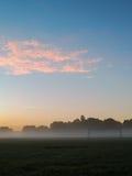 Pastellfärgad soluppgång över fotbollmål Arkivbilder