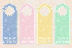 pastellfärgade dörrhängare Arkivbilder