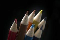 Pastelli colorati sul nero Fotografia Stock