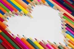 Pastelli nella forma del cuore come immagine del fondo Immagine Stock Libera da Diritti