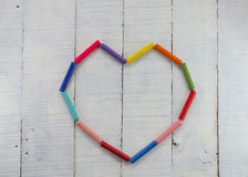 Pastels arranged in heart shape Royalty Free Stock Photos