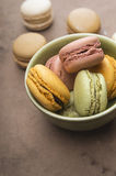 Pastels macarons in bowl Stock Images