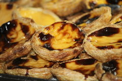 Pastel de Nata, a speciality of Portugease cusine. Portuguese Custard Tarts Pastel de Nata or de Belem. A close-up of traditional Portuguese custard pastries stock photos