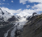 Pasterze. The Pasterze glacier, largest and longest glacier in the Austrian Alps, descending from the shoulder of mount Grossglockner, falling over the cliff of Royalty Free Stock Photography