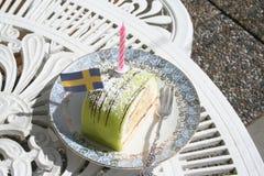 Pasticceria del marzapane con la bandiera e la candela Fotografia Stock