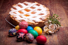 Pastiera Napoletana. International Cuisine - Desserts - Neapolitan Pastiera and colorful Easter eggs. Pastiera is a wheat and ricotta pie that is also known as Stock Images