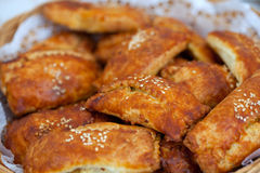 Pasties filled with minced meat and sesame seeds Royalty Free Stock Photography