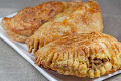 Pasties filled with minced meat on a white plate w Stock Image