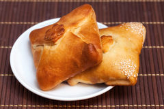 Pasties stuffed meat on bamboo napkin, close up Royalty Free Stock Photography