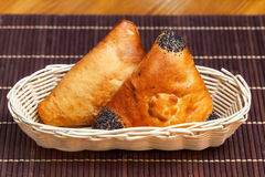 Pasties stuffed meat in basket on bamboo napkin, close up Royalty Free Stock Photos
