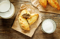 Pasties stuffed meat and glass of milk Royalty Free Stock Image