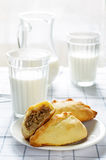 Pasties stuffed meat and glass of milk Royalty Free Stock Photo