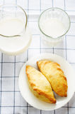 Pasties stuffed meat and glass of milk Royalty Free Stock Images