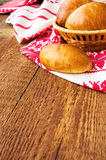 Pasties stuffed meat on a wood background, selective focus Royalty Free Stock Image